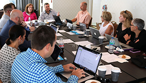 2018-19 NSPRA Executive Board sits at a table to discuss association business